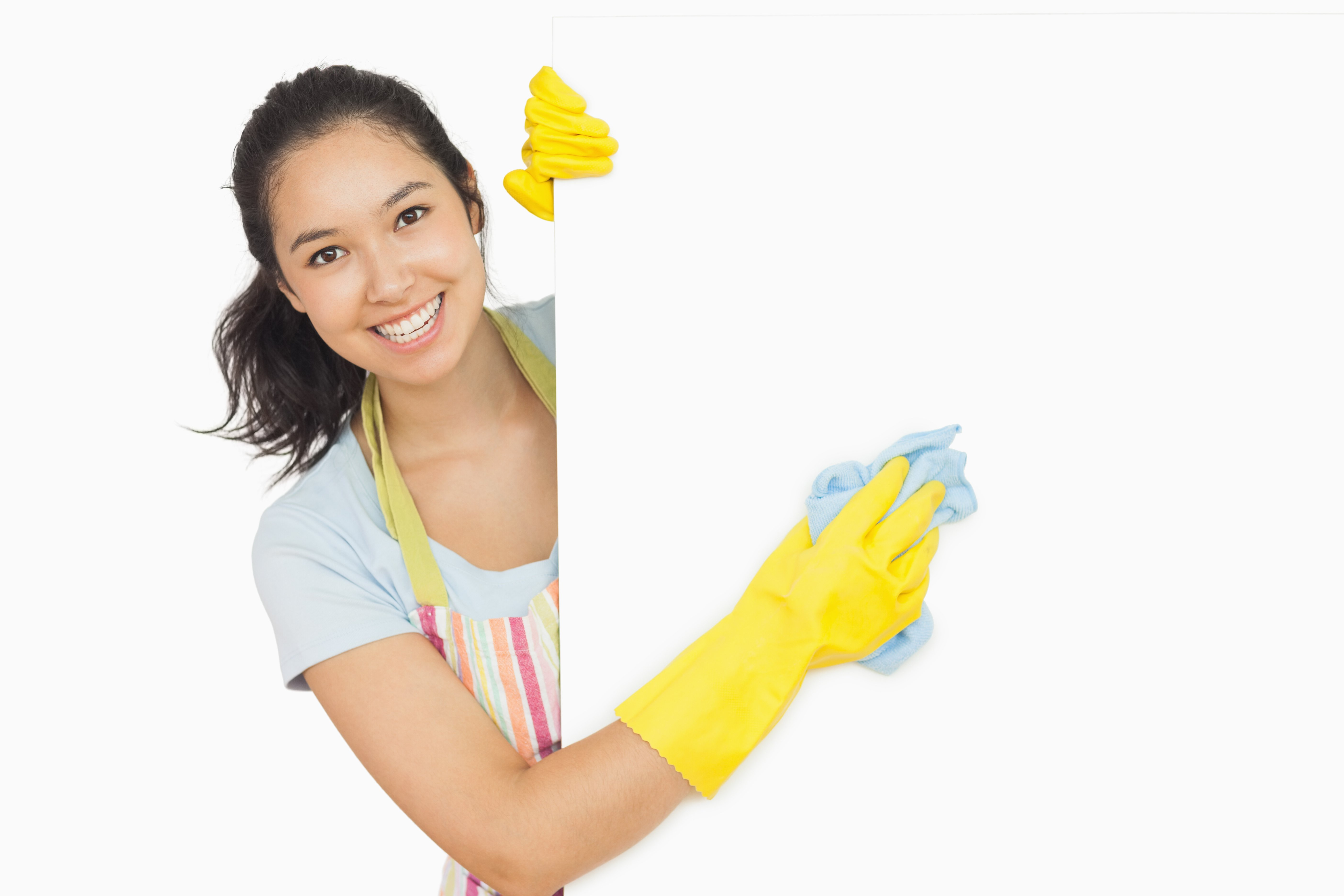 Cheerful woman cleaning white surface in apron and rubber gloves-2_edited2